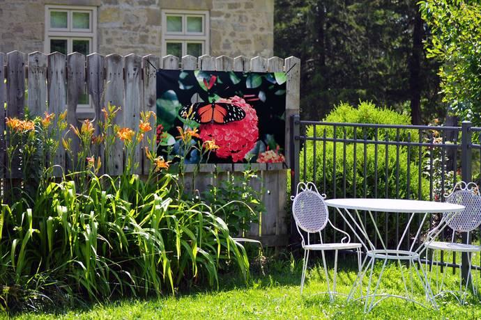 Tuinposters op schutting